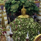 Lotus flowers are thrown by worshippers on to a Buddha statue during the Lotus Flower Receiving Festival in Bang Phli district, Samut Prakarn province, east of Bangkok, Thailand. The annual festival was held to celebrate the finish of Buddhist Lent and the end the rainy season. (AP Photo/Apichart Weerawong)