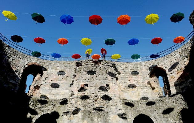 Umbrellas art covers historic tower