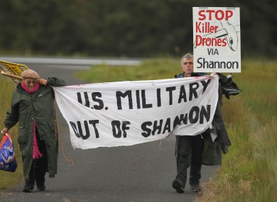 Shannon Peace activists Niall Farrell and Margaretta D'arcy as they attempt to block the runway of Shannon Airport, Sunday October 7, 2012.
