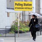 Childrens Rights Referendum Campaigns. A woman walks past a polling station this morning as polls opened for the Children's Referendum in Dublin. Photo: Laura Hutton/Photocall Ireland