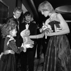 Seven year old Drew Barrymore presents the Princess of Wales with a cuddly toy version of ET at the Empire cinema, in Leicester Square, London. Also pictured are Henry Thomas, Robert MacNaughton, and the film's director Steven Spielberg. 