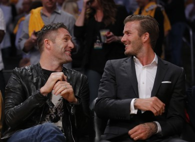Los Angeles Galaxy's Robbie Keane, left, and David Beckham at the Lakers-Mavs game this week.