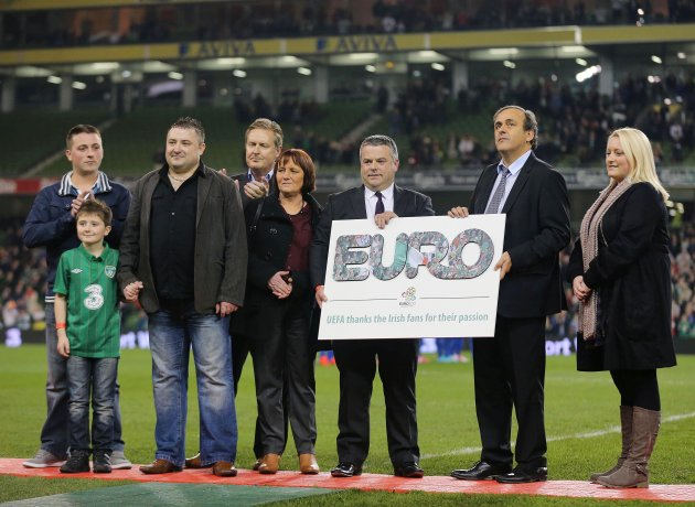 Michel Platini makes a presentation to the family of James Nolan 14/11/2012