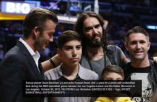 Robbie Keane labelled 'unidentified fan' next to Beckham and Russell Brand at Lakers Game