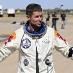 FELIX BAUMGARTNER - An Austrian skydiver who was known by few until he succeed in the not-very-minor feet of recording humankind's highest-ever freefall jump, by skydiving from 24 miles above Earth... and landing on his feet. (AP Photo/Ross D. Franklin)