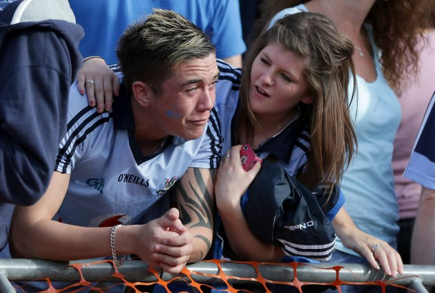 A distraught Dublin fan is comforted after their loss to Mayo 2/9/2012Ê
