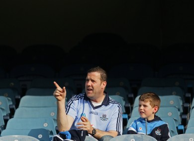 'And that there is Hill 16'. Dermot O'Brien with his son Craig.