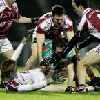 No room for maneouvre in McHale Park. Mayo's Alan Dillon is crowded out by NUIG's Gary Sweeney, Donal O'Sullivan, Ciaran McDonald and Laurence Healy. But come the final whistle Mayo are celebrating early season silverware as they claimed victory. (INPHO/James Crombie).