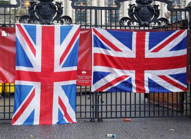 Thousands of loyalists have marched to City Hall in Belfast to protest against the decision to restrict the number of days that the Union flag is flown on the building.