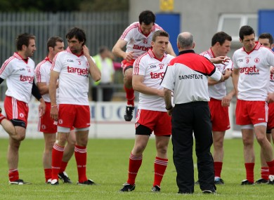 Tyrone boss Mickey Harte with his players.