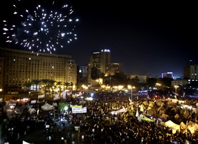 Fireworks burst over Tahrir Square as protesters gather in Cairo this evening