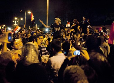 Egyptian protesters chant anti Muslim Brotherhood slogans during a demonstration in front of the presidential palace in Cairo, Egypt