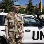 20 May: Norwegian Maj. Gen. Robert Mood, head of the UN observer team in Syria, stands near a UN observers car in Zabadani neighbourhood in Damascus. The team pulled out of Syria because of escalating violence in August. (AP Photo/Muzaffar Salman)