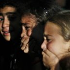 4 June: Relatives of Free Syrian Army soldier, Moayad Ghafir, who was killed during clashes with the regime gunmen, mourn over his dead body before his funeral in his family house on the outskirts of Idlib. (AP Photo)