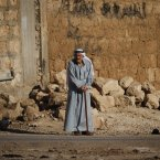 5 June: An elderly Syrian man stands on the side of a street in the town of Taftanaz, 15 km east of Idleb. (AP Photo)
