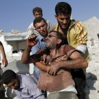 15 August: A Syrian man reacts after seeing the body of his relative buried in rubble after an air strike destroyed at least ten houses in the town of Azaz on the outskirts of Aleppo. (AP Photo/ Khalil Hamra)