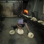 22 September: A Syrian man works at a bakery in the in Saif Al Dawla neighbourhood of Aleppo. (AP Photo/ Manu Brabo)