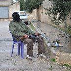1 February: A Syrian rebel guards an alley, at Rastan area in Homs province. (AP Photo)