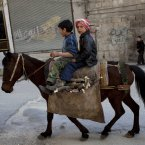 25 February: Children ride a horse in Kafar Taharim. (AP Photo/Rodrigo Abd)