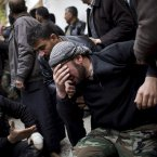 13 December: A Free Syrian Army fighter cries during the funeral of his comrade killed by the Syrian Army in Azaz. (AP Photo/Manu Brabo)