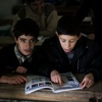 13 December: A Syrian child is seen at his classroom in a city under control of the FSA. (AP Photo / Manu Brabo)