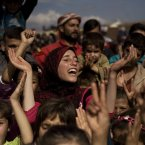 27 October: Syrians chant slogans during a demonstration in a refugee camp near Atma, Idlib. (AP Photo/ Manu Brabo)