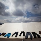 26 October: Clothes belonging to a displaced Syrian family dry on the top of a tent in a refugee camp near Atma, Idlib province, Syria. (AP Photo/ Manu Brabo)
