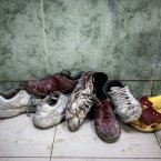 1 November: A pile of shoes covered by blood from wounded or dead residents lies at the entrance of the emergency ward at a hospital in the Tarik Al-Bab neighbourhood in Aleppo. (AP Photo/Narciso Contreras)