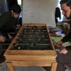 14 November: Rebels play foossball in their base in on the outskirts of Aleppo. (AP Photo/ Khalil Hamra)