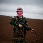 10 December: A Free Syrian Army fighter takes position close to a military base, near Azaz. (AP Photo/Manu Brabo)