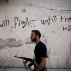 10 September: A Free Syrian Army fighter walks through a street in Amariya district in Aleppo. (AP Photo/ Manu Brabo, FIle)