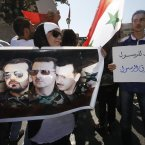 14 September: Pro-Assad supporters chant slogans during a demonstration in Damascus. (AP Photo/Muzaffar Salman)