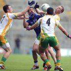 Crowded out. Kerry's Paul Galvin has nowhere to go as Donegal players swarm around him. (INPHO/Lorraine O'Sullivan).