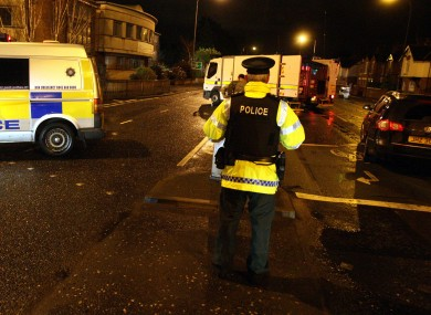 The scene last night, as police sealed off Upper Newtownards Road.