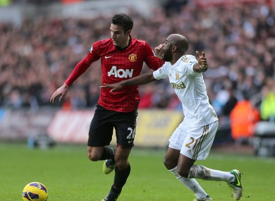 Swansea City's Dwight Tiendalli (right) and Manchester United's Robin van Persie (left) battle for the ball.