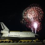 Fireworks burst in the air over space shuttle Atlantis after it arrived at its new home at the Kennedy Space Center Visitor Complex in November. Image: AP Photo/John Raoux