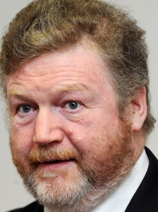 Fine Gael Minister for Health, Dr James Reilly with a copy of the report