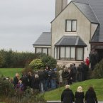 Mourners gather at the home of murdered Detective Garda Adrian Donohoe at Lordship, Jenkinstown, Dundalk. (Image: Niall Carson/PA Wire)
