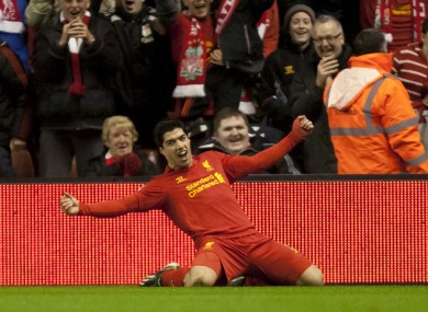 Liverpool's Luis Suarez celebrates after scoring against Sunderland during their English Premier League soccer match at Anfield.