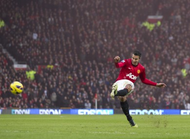 Manchester United's Robin van Persie takes a free kick against Liverpool.
