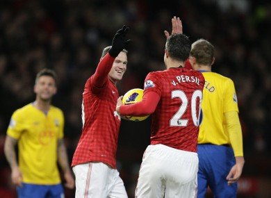 Rooney: celebrates with Robin van Persie.