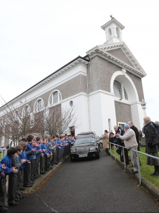 Children from Scoil Mhuire, Marino line the route as the cortege leaves the church.