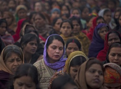 Indian women offer prayers for the gang rape victim.