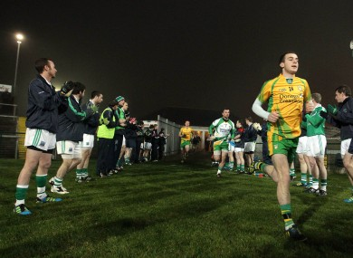 Fermanagh players welcome Donegal with a guard of honour.