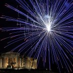 Fireworks explode over the ancient Parthenon temple at the Acropolis Hill. (AP Photo/Petros Giannakouris)