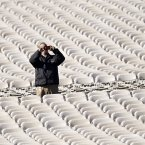 A workman snaps a souvenir photo amid thousands of folding chairs on the West Lawn on Capitol Hill in Washington. (AP Photo/J. Scott Applewhite)