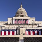 The West Front of the U.S. Capitol is dressed in red, white and blue. (AP Photo/J. Scott Applewhite)