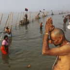 Indian Hindu pilgrims bathe at Sangam. (AP Photo/Kevin Frayer)