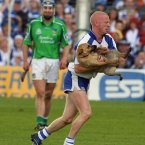 Mullane clears the pitch of a canine invasion as Waterford claim provincial glory against Limerick.