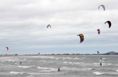 Kite surfer rescued after becoming separated from his board
